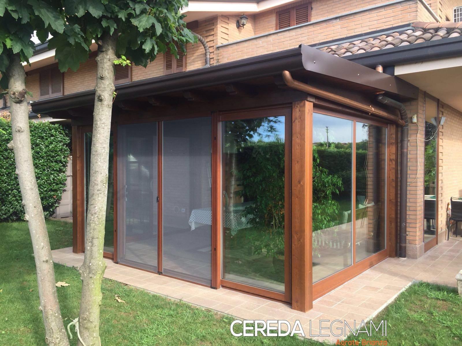 Tetti in legno tettoie pergole e pensiline milano e brianza for Foto di portici per case