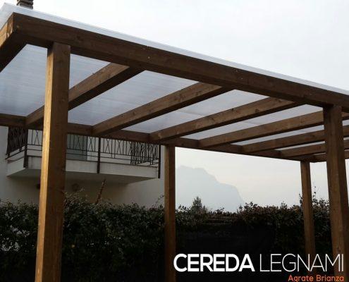 Struttura legno e policarbonato per copertura veicoli